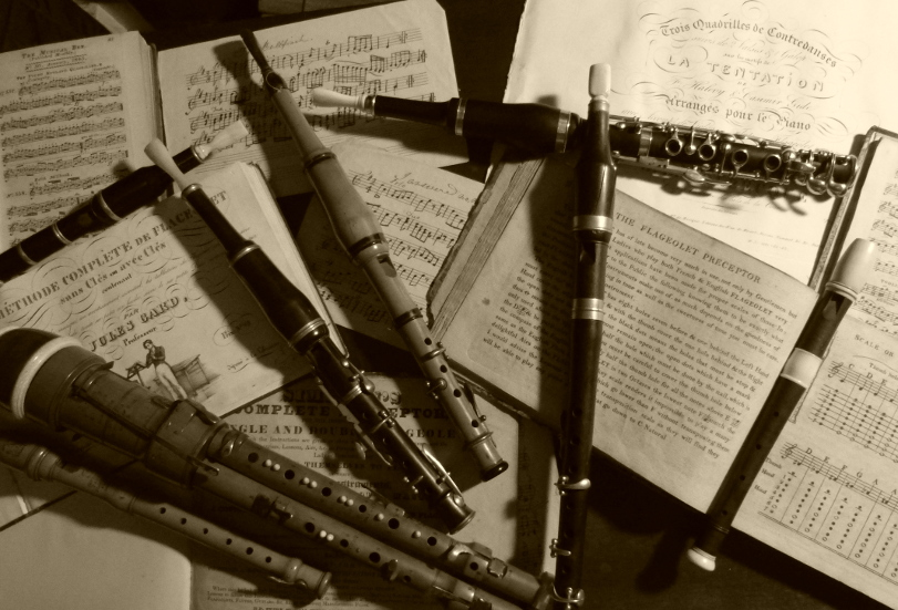 A sepia photgraph of a selection of flageolets resting on some music.
