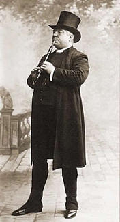 A photograph of an actor carrying an English flageolet in Victorian dress.